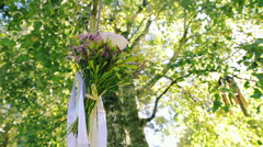 Wedding Bouquet Ribbons Tied to the Swings Under the Tree - stock footage