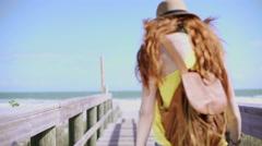 Caucasian female making selfie video on boardwalk - stock footage