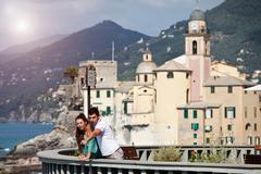 Couple on vacation admiring scenery - stock photo