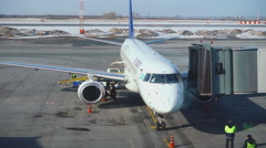 Aircraft Embraer 190 parked Stock Footage
