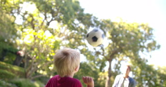 Modern Dad and Little Boy Playing Ball, Barefoot, in Garden - stock footage