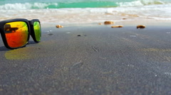 Sunglasses on the tropical beach Stock Footage