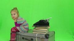 Girl writes for retro typewriter Stock Footage