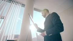 Businessman write information at plastic white board in modern office building Stock Footage