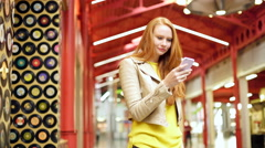 Female hipster in shopping mall with smart phone USA Stock Footage