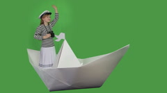 Girl playing in the ship's captain Stock Footage
