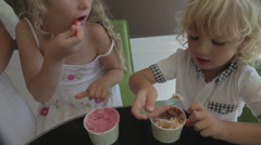 Family Eating Ice Cream In Town On A Hot Summer Day Stock Footage
