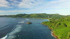 Aerial view of Anse Royale coast with clear sea water and green lush hills. Stock Footage