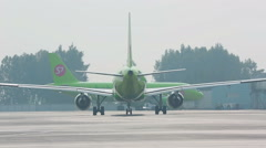 Two S7 airplanes at airport Stock Footage