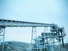 Low angle view of screening conveyor at quarry site Stock Photos