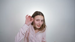 The girl pretending insane can hide inner fear and frustration. RAW video record - stock footage