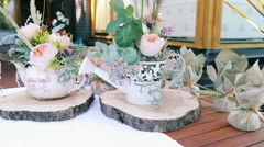 Wedding Decoration of Porcelain Teapot and a Small Watering Can Decorated With Stock Footage
