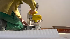 Sawing laminate pieces with electric saw. Super Slow Motion - stock footage