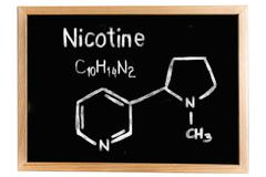 Blackboard with the chemical formula of Nicotine Stock Illustration