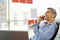 Businessman talking on cell phone Stock Photos