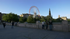 People admiring the monuments of the East Princes Street Gardens, Edinburgh Stock Footage