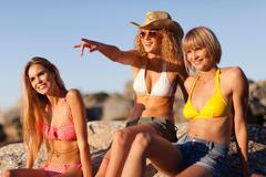 Women admiring beach together - stock photo