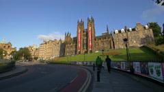 People walking on the Mound street near New College, Edinburgh Stock Footage