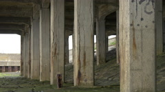 Pillars of an old building on the coast of Edinburgh Stock Footage