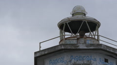Low angle view of the old Lighthouse at the entrance to Leith Docks, Edinburgh Stock Footage