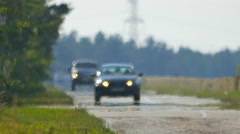 The movement of vehicle on a country road in the background of forest. Real time Stock Footage