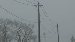Powerlines sway in severe ice and wind storm in Ontario 2016 Stock Footage