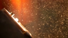 The bright spotlight on the background of the dust particle. Real time capture - stock footage