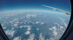 Super wide window view from an aircraft over scattered clouds. Stock Footage