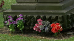 Flowers at the bottom of a gravestone at Greyfriars Kirkyard, Edinburgh Stock Footage