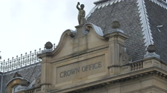 Sculpture of a boy on Crown Office building, Edinburgh - stock footage