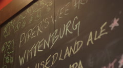 Craft Beer Chalkboard Menu with Decorative Artwork at Restaurant Bar / Brewery Stock Footage