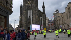 Many people and police officers standing in front of The Hub , Edinburgh Stock Footage