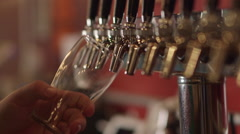 Bartender Pouring Craft Beer from Tap into Pint Glass at Restaurant Bar/Brewery Stock Footage