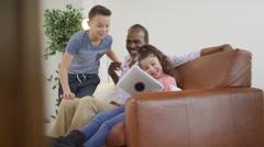 4K Happy grandfather & grandchildren taking selfie with computer tablet Stock Footage
