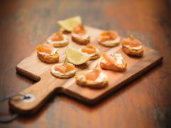 Scottish smoked salmon and cream cheese canapes on board Stock Photos