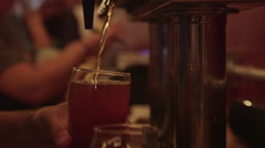 Bartender Pouring Craft Beer from Tap into Pint Glass at Restaurant Bar/Brewery - stock footage