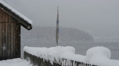 Wooden house and flag near Hallstatter See on a winter day, Hallstatt Stock Footage