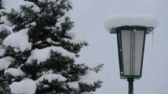 View of a lamp post and fir tree covered with snow, Hallstatt Stock Footage