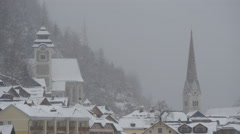 Saint Michael Church, Parish Church and houses on a winter day, Hallstatt Stock Footage