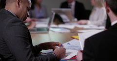 4k business people in a board room meeting, taking notes. Slow motion. Stock Footage