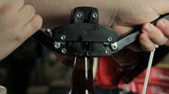 Homebrewer Capping Glass Bottles filled with Craft Beer Stock Footage
