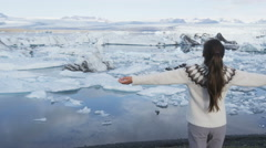 Iceland travel tourist happy in nature landscape - Jokulsarlon glacial lagoon Stock Footage