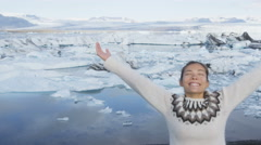 Serene woman with arms outstretched Iceland nature - famous tourist destination Stock Footage