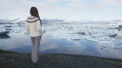 Iceland travel tourist enjoying view of landscape - famous tourist destination Stock Footage