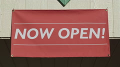 Now Open Outdoor Sign Handing over Entrance of Small Business - stock footage