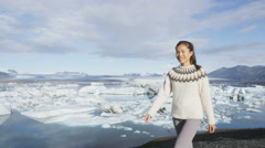 Woman walking outdoors in Iceland nature landscape - Jokulsarlon glacial lagoon Stock Footage