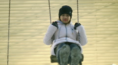 Young woman on swing in winter 4k UHD (3840x2160) Stock Footage