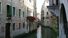 Lonely gondola in the narrow Venice Canal Stock Footage