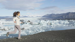 Woman happy running of joy in Iceland nature - Woman active lifestyle Stock Footage
