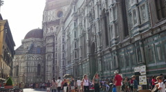 Tourists are walking near the Cathedral di Santa Maria del Fiore Florence, Italy - stock footage